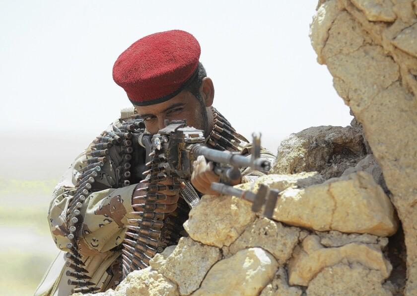 An Iraqi Shiite Muslim fighter takes position outside the Shiite holy city of Najaf, 100 miles south of Baghdad.