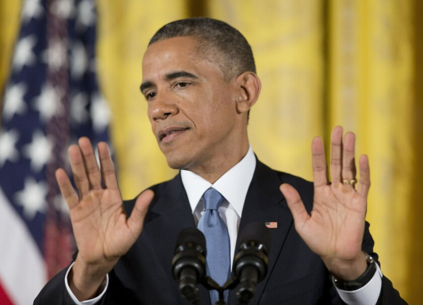 President Barack Obama talks at a White House news conference Wednesday to discuss Tuesday's election.