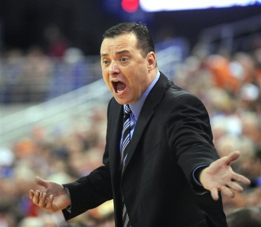 """This is a March 7, 2009 file photo showing Kentucky coach Billy Gillispie shouting to a referee during  NCAA college basketball play against Florida  in Gainesville, Fla. Gillispie is out as Kentucky's basketball coach.  The university says it will announce """"a change in the head coaching position"""