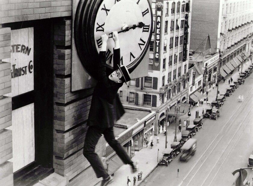 "Actor Harold Lloyd hangs from a clock in a famous image from his 1923 ""Safety Last!"" romantic comedy."