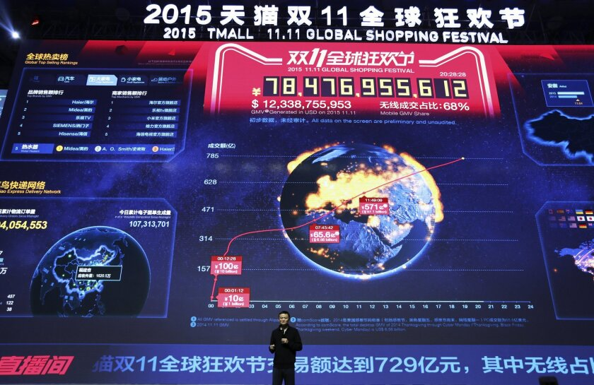 """FILE - In this file photo taken Nov. 11, 2015, Jack Ma, executive chairman of the Alibaba Group, speaks in front of a giant screen showing real-time sales figures of e-commerce giant Alibaba, during a press conference for the """"Singles' Day"""" online shopping festival held at National Aquatic Center,"""