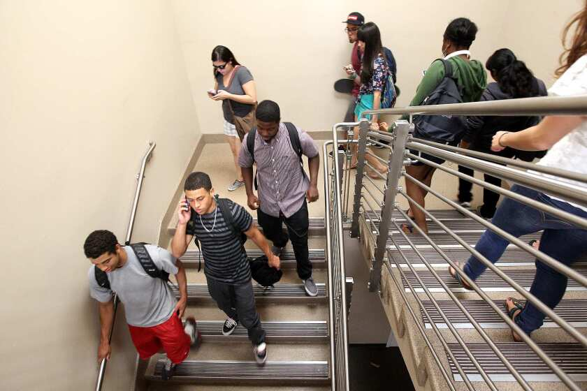 """Jeffrey MacGillivray, 20, second from bottom left, heads out after his philosophy class in 2012 at El Camino Community College in Torrance. """"I was thinking I can just go to community college, do my two years and transfer,"""" MacGillivray said. """"I had no idea I'd probably end up at El Camino for four years."""""""