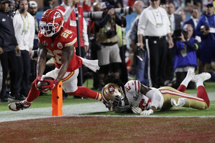 Kansas City Chiefs running back Damien Williams scores the deciding touchdown past 49ers cornerback Richard Sherman in the fourth quarter.