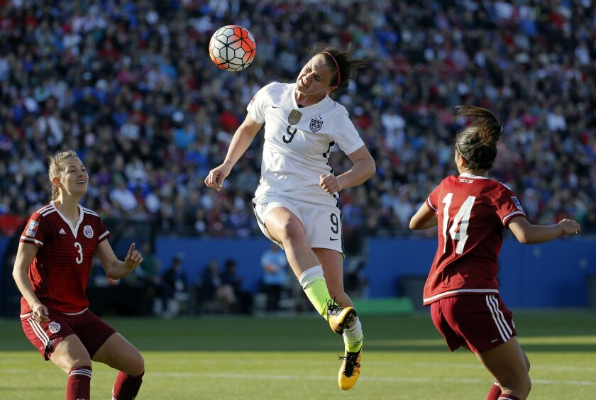 Mexico defender Ganelly Farias (3) and Annia Mejia (14) defend against a header shot at the net by United States midfielder Lindsey Horan (9) in the second half of a CONCACAF Olympic qualifying tournament soccer match, Saturday, Feb. 13, 2016, in Frisco, Texas. The U.S. won 1-0. (AP Photo/Tony Guti