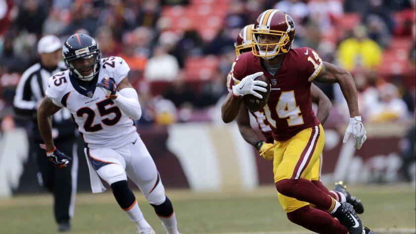 Redskins wide receiver Ryan Grant (14) runs the ball Denver Broncos cornerback Chris Harris.