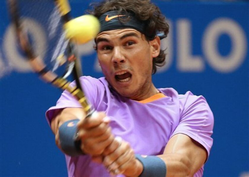 Spain's Rafael Nadal returns the ball to Argentina's Martin Alund during a Brazil Open ATP tournament semifinal tennis match in Sao Paulo, Brazil, Saturday, Feb. 16, 2013. (AP Photo/Andre Penner)