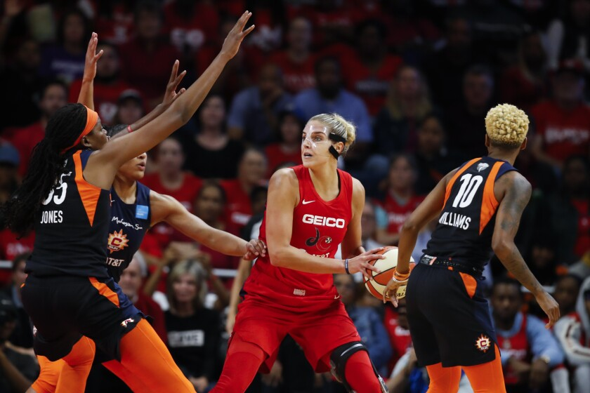 Washington Mystics forward Elena Delle Donne, center, guarded by Connecticut Sun players in 2019.