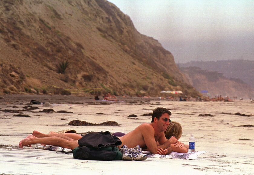 An unidentified couple from Los Angeles enjoy sunbathing in the nude at Black's Beach in San Diego (AP file/Denis Poroy)