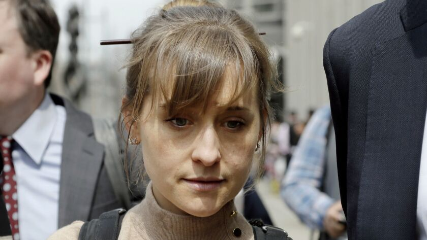 Actress Allison Mack leaves Brooklyn federal court Monday, April 8, 2019, in New York. Mack pleaded
