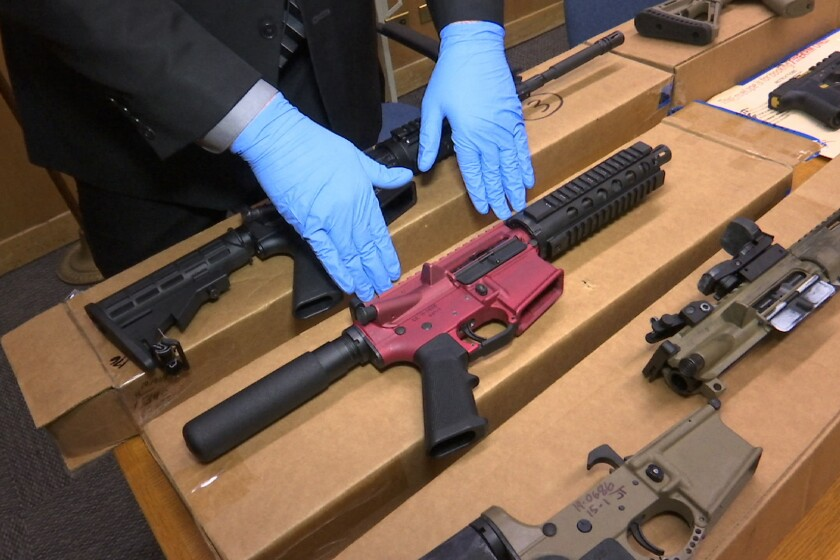 """In this Nov. 27, 2019 file photo, """"ghost guns"""" are displayed at the headquarters of the San Francisco Police Department."""