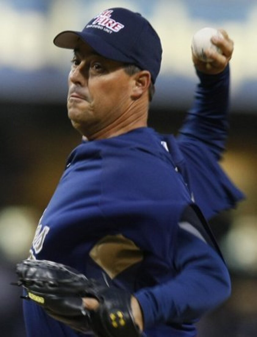 Padres' Greg Maddux throws against the Angels in the first inning of their exhibition game Friday at Petco Park. UT photo by John McCutchen
