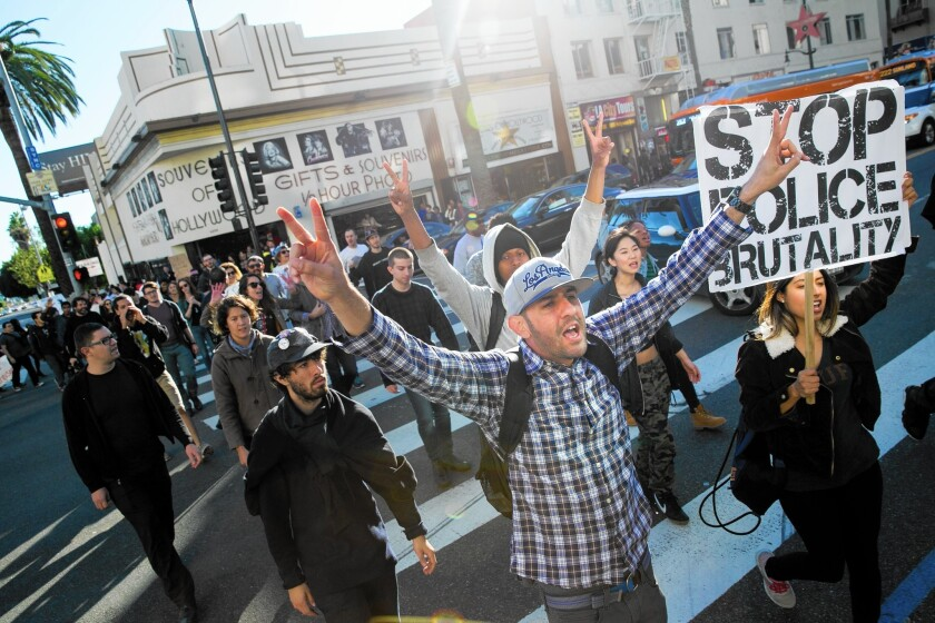 Almost three-fourths of voters say race relations are excellent or good in their neighborhoods. But just under half hold that view of California as a whole, and barely a quarter say race relations nationwide are excellent or good. Above, protesters march in Hollywood in December.