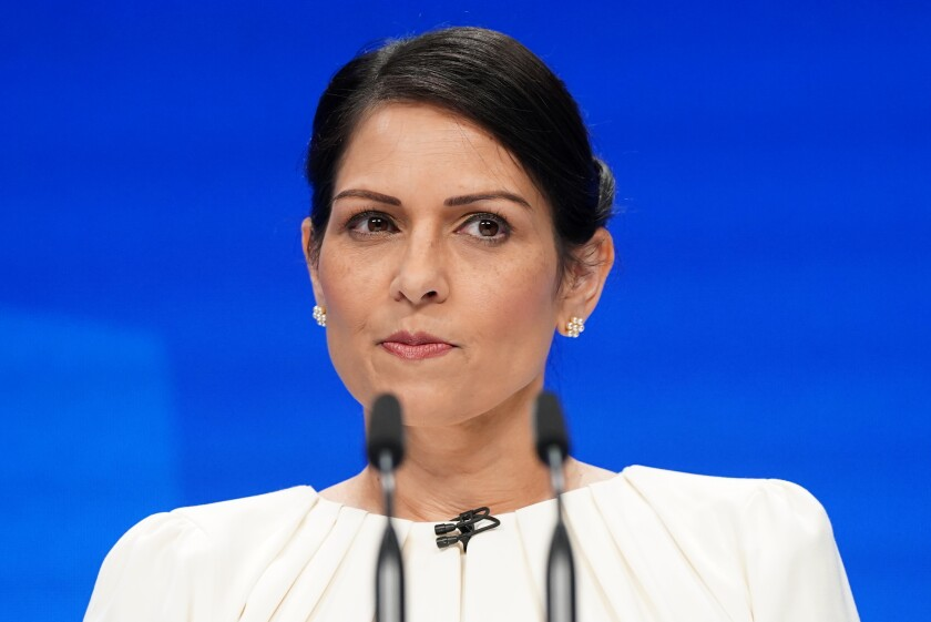 Britain's Home Secretary Priti Patel pauses as she speaks at the Conservative Party Conference in Manchester, England, Tuesday, Oct. 5, 2021. (Stefan Rousseau/PA via AP)