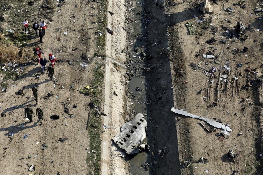 Rescue workers search the scene where a Ukrainian plane crashed in near Tehran in January.