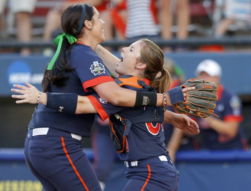 Auburn's Carlee Wallace (0) and Rachael Walters (19) celebrates their win over Georgia in an NCAA Women's College World Series game in Oklahoma City, Saturday, June 4, 2016. (Sarah Phipps/The Oklahoman via AP) LOCAL STATIONS OUT (KFOR, KOCO, KWTV, KOKH, KAUT OUT); LOCAL WEBSITES OUT; LOCAL PRINT OU