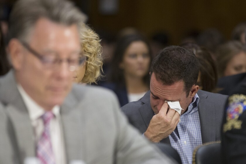 Brad Steinle, Kathryn Steinle's brother, cries while listening to testimony from his father at a Senate Judiciary Committee hearing July 21.
