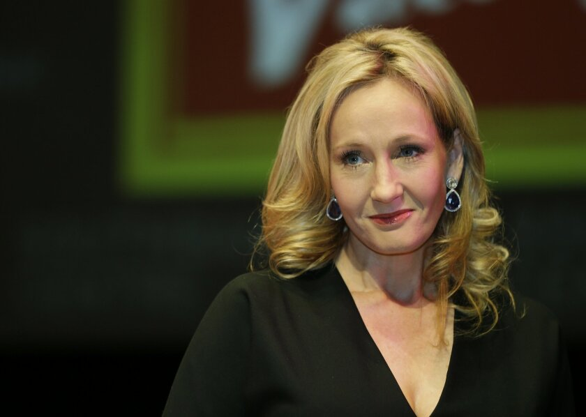 """FILE This is a Thursday, Sept. 27, 2012 file photo of British author J.K. Rowling as she poses for the photographers during photo call to unveil her new book, entitled: 'The Casual Vacancy', at the Southbank Centre in London. A lawyer who let slip J.K. Rowling's secret thriller-writer identity has been fined 1,000 pounds ($1,645) for breaching client confidentiality rules. Chris Gossage of London law firm Russells Solicitors — which represents Rowling — told a friend of his wife that the """"Harry Potter"""" creator was author of """"The Cuckoo's Calling,"""" published last year under the name Robert Galbraith. The friend tweeted the information, and it was followed up by the Sunday Times. (AP Photo/Lefteris Pitarakis, File)"""