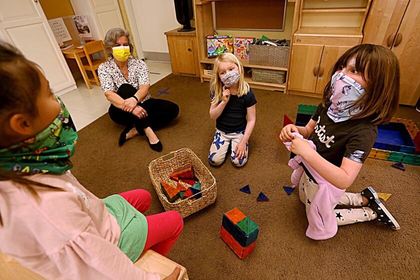 Kindergarten children play with blocks.