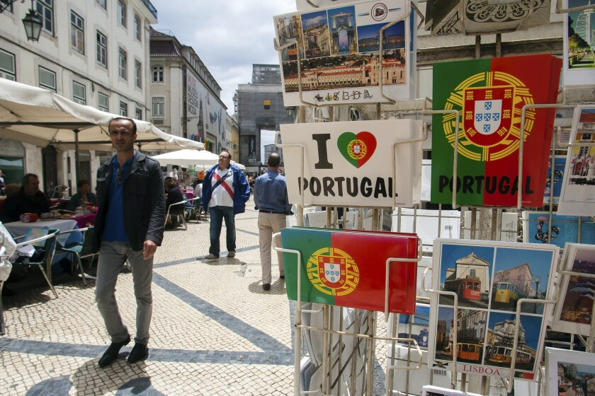 When postcards were introduced in Austria in 1869, three million passed through the post office within the first three months. Nations around the world quickly issued their own postcards and during 1870 in Britain, seventy-five million were sent. Above: A display of Portugal-themed postcards is displayed for sale outside a store on Augusta Street in Lisbon, Portugal.