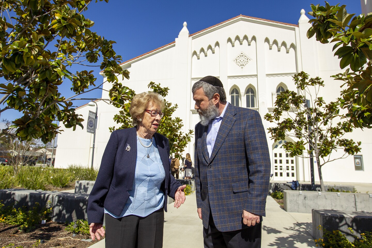 Eva Schloss, 89, a Holocaust survivor and Anne Frank's stepsister, speaks with Chabab Rabbi Reuven Mintz during a press conference at Newport Harbor High school on Thursday, March 7. Schloss met and talked with students invoived in a party made Nazi salutes around a Swastika that made of red cups during an off-campus party last week.