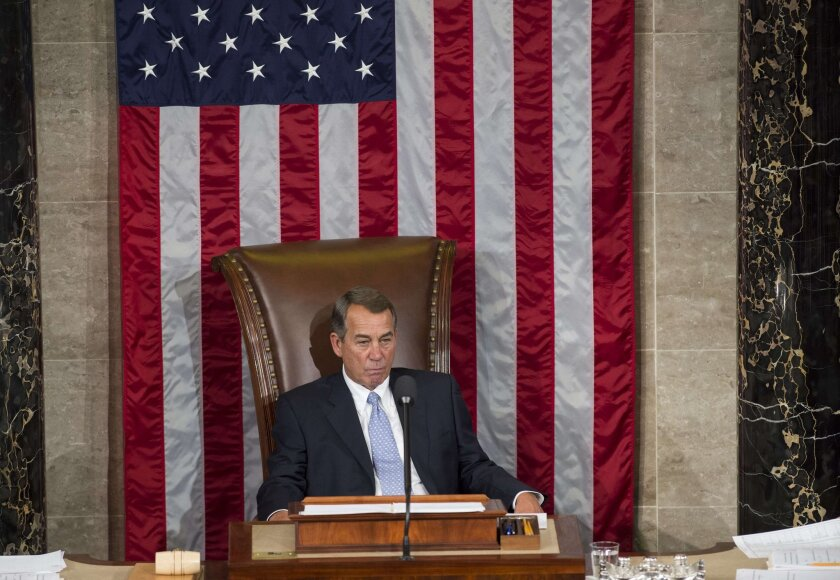 Rep. John A. Boehner (R-Ohio) sits in the House speaker's chair for the final time Thursday.
