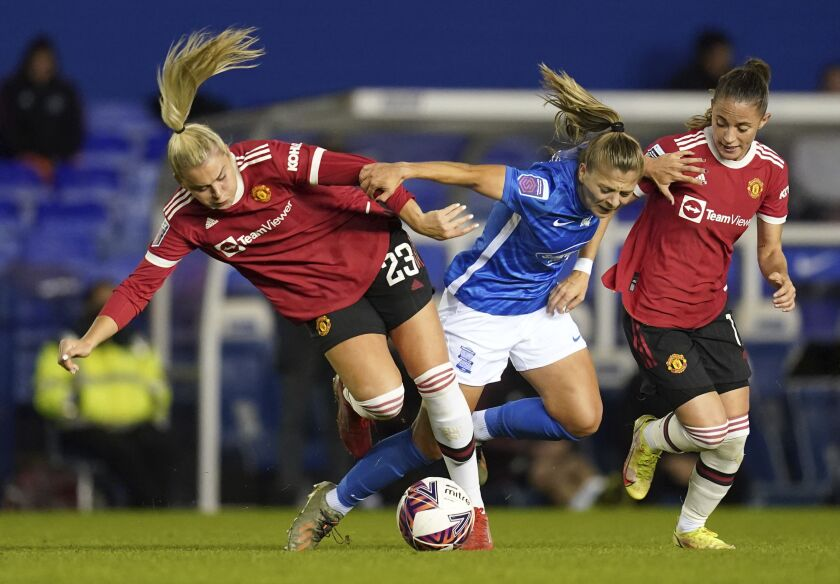 From left, Manchester United's Alessia Russo, Birmingham City's Veatriki Sarri, and Manchester United's Ona Batlle battle for the ball during the FA Women's Super League match at St. Andrew's, Birmingham, England, Sunday, Oct. 3, 2021. (David Davies/PA via AP)