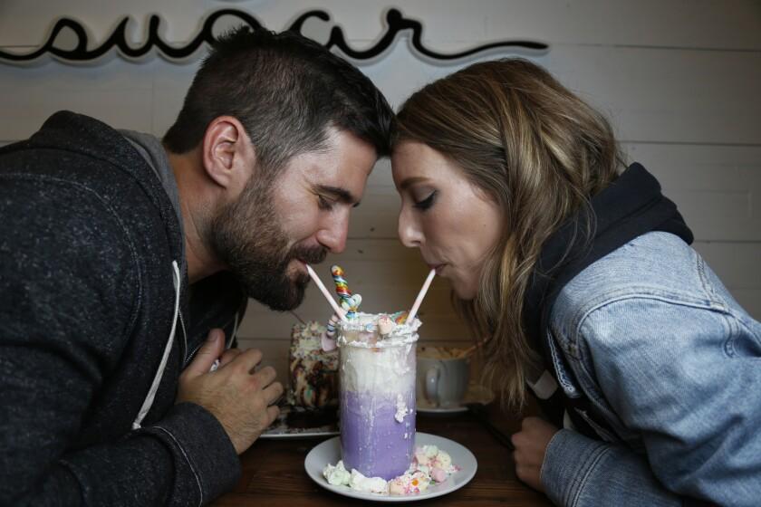 Daters sipping milkshake