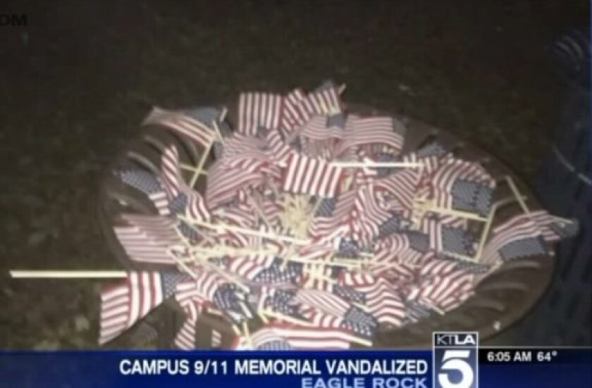 Flags that were part of a 9/11 memorial at Occidental College were dumped into a trash can.