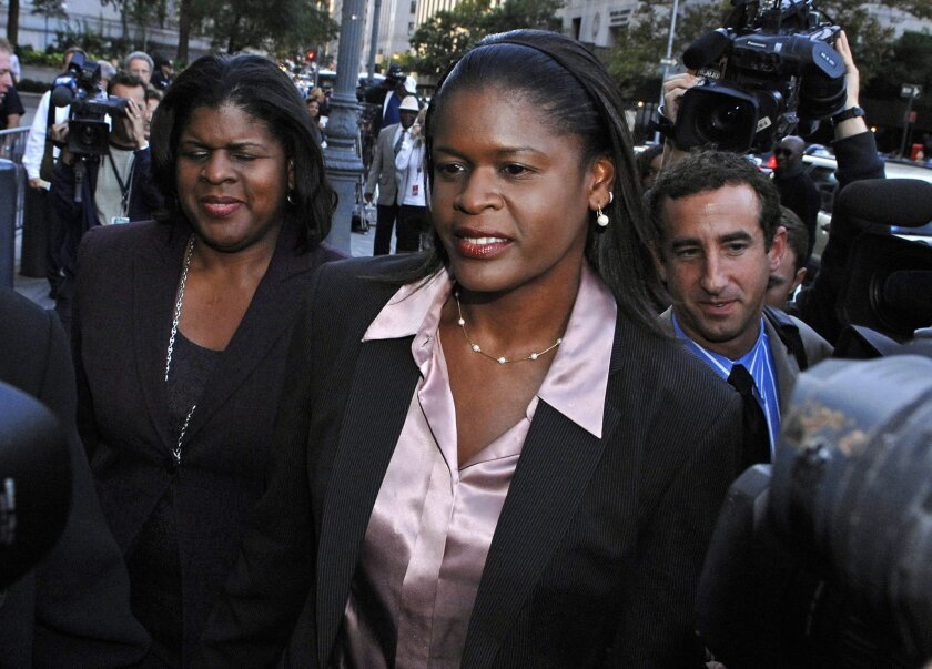 File-This Oct. 1, 2007, file photo shows former New York Knicks executive Anucha Browne Sanders  exiting Manhattan federal court in New York. Sanders won an $11.5 million harassment suit against  Isiah Thomas, the Garden and chairman Jim Dolan in 2007. Thomas, the former Knicks president and coach,