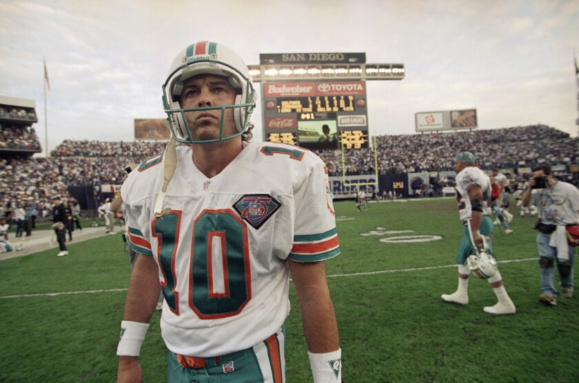 Miami Dolphins kicker Pete Stoyanovich walks off the field after the Dolphins' 22-21 loss to the San Diego Chargers in an NFL football playoff game Jan. 8, 1995 in San Diego. Stoyanovich had a chance to kick a 48-yard field goal with 6 seconds left to win the game but missed.