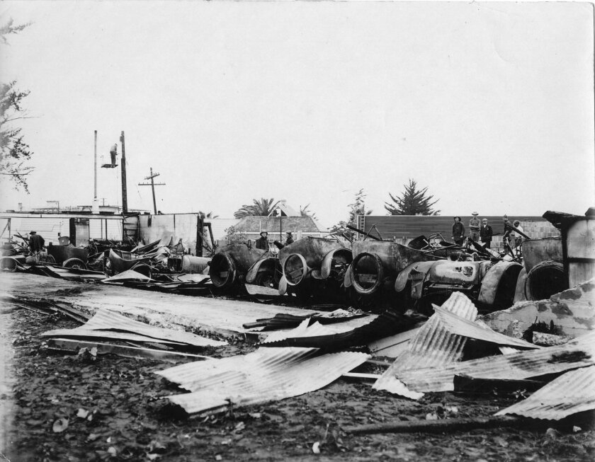 """A 1921 automobile garage fire turned """"proud packards, Cadillacs and other high class cars"""" into indeterminable heaps of twisted metal and pools of rubber."""
