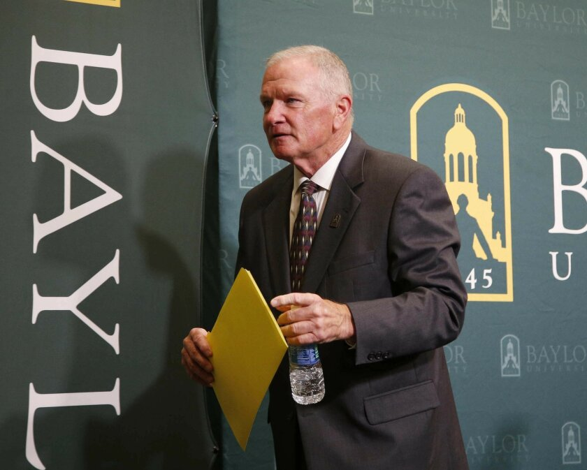 In this June 3, 2016, file photo, Baylor interim football coach Jim Grobe leaves a news conference in Waco, Texas. Grobe has a masters degree in counseling, which comes in handy dealing with student-athletes on and off the field. Yet, Baylor's acting head coach knows that doesn't qualify him to handle issues such as domestic violence and sexual assault. (Rod Aydelotte/Waco Tribune Herald, via AP, File)