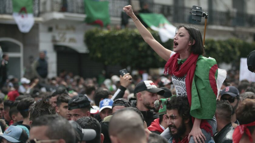 A protester chants slogans during a demonstration against the country's leadership, in Algiers, Frid