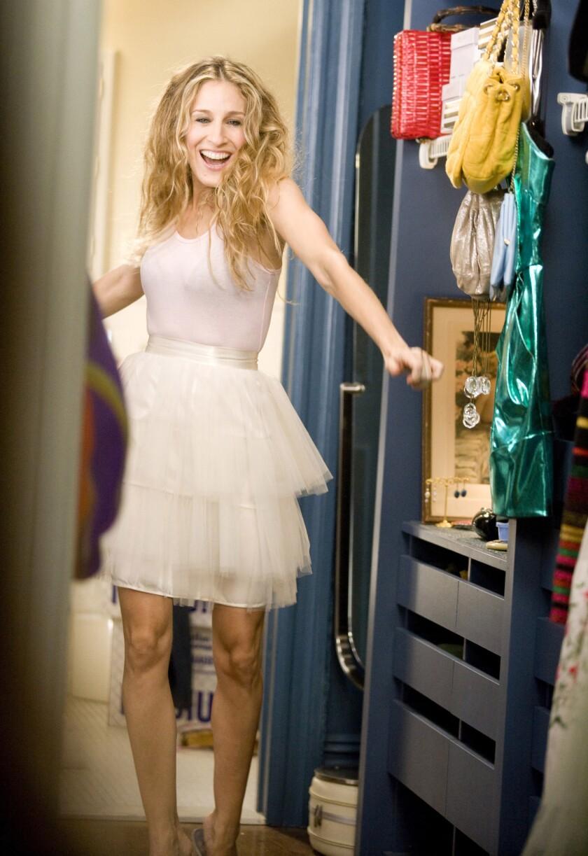 Sarah Jessica Parker as Carrie Bradshaw.