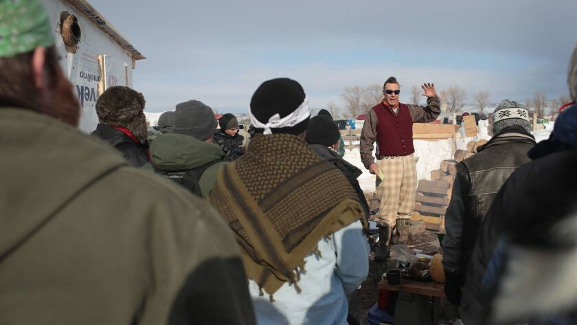Military veterans are briefed on camps rules and their mission at Oceti Sakowin Camp on the edge of the Standing Rock Sioux Reservation on Saturday outside Cannon Ball, N.D.