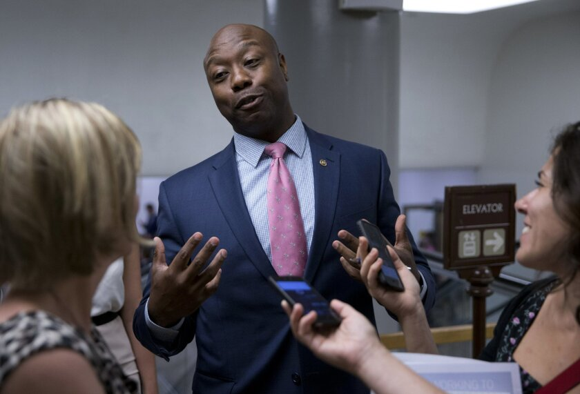 FILE - In this June 21, 2016, file photo, Sen. Tim Scott, R-S.C., talks with reporters on Capitol Hill in Washington. Scott candidly described being stopped by police and Capitol Hill cops because of the color of his skin. It's an experience all too familiar to many of his African-American colleagu