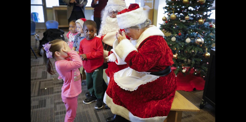 Santa and Mrs. Claus visit Father Joe's Villages