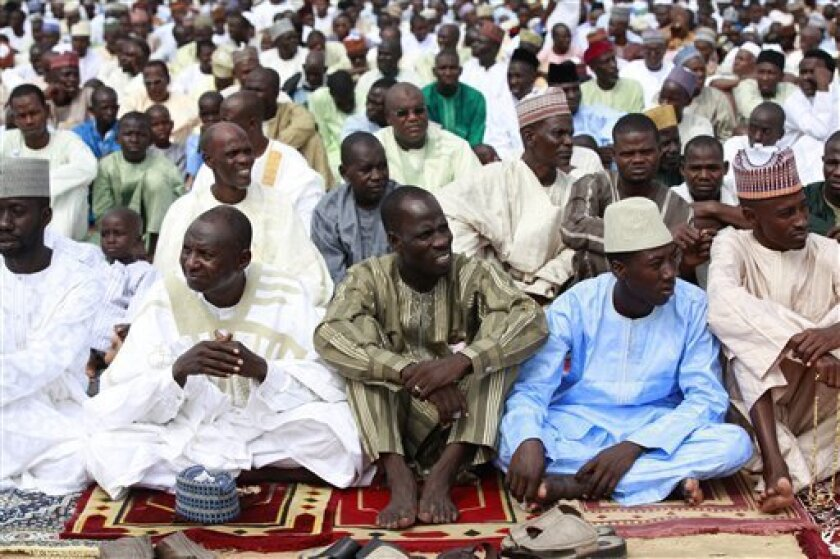 In this photo taken Thursday, Aug. 8, 2013, Nigeria Muslims attend Eid al-Fitr prayers in Maiduguri, Nigeria. Suspected Islamic militants wearing army fatigues gunned down 44 people praying at a mosque in northeast Nigeria, while another 12 civilians died in an apparently simultaneous attack, security agents said Monday Aug. 12, 2013. The slayings occurred Sunday morning at a mosque in Konduga town, some 35 kilometers (22 miles) outside Maiduguri, the capital of Nigeria's Borno state. (AP Photo/