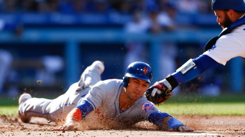 LOS ANGELES, CALIF. - MAY 27: New York Mets right fielder Michael Conforto (30) is thrown out at hom