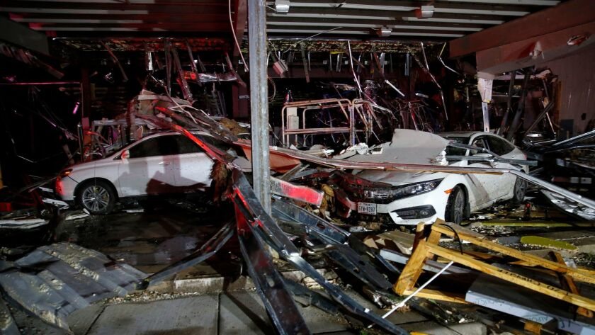 A Dodge dealership near Canton, Texas, is in ruins after a tornado blew out its walls.