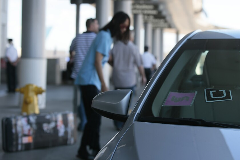 A car with Uber and Lyft stickers sits in front of the Tom Bradley International Terminal at LAX in October.