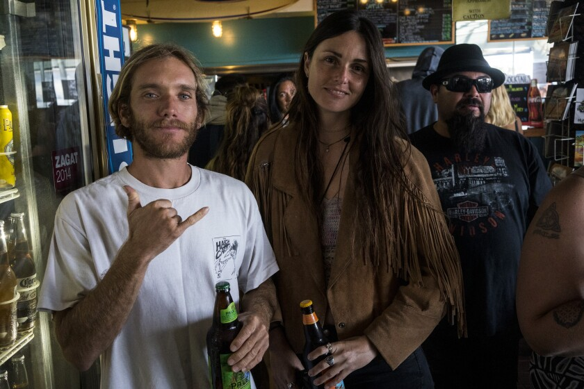 "4Surfer Tom Skene and Angelika Oatway: ""I really like how nothing changes,"" she says."