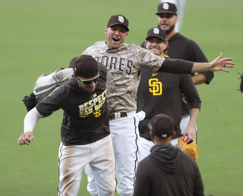 The Padres, including outfielder Wil Myers, left, and pitcher Craig Stammen, beat the Mariners 7-4 on Sunday.