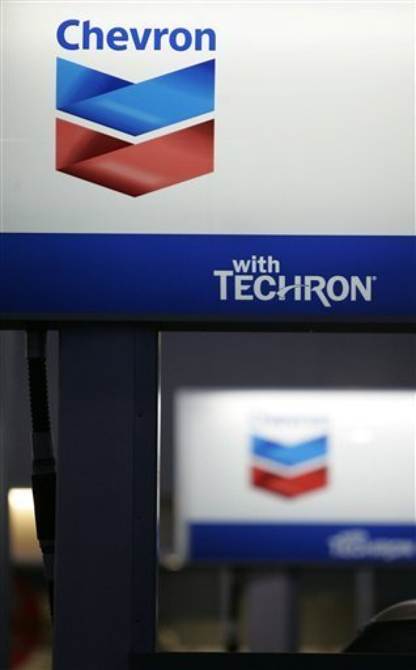 FILE - In this file photo made July 8, 2009, the Chevron logo are seen at a gas station in Palo Alto, Calif. Chevron will buy natural gas producer Atlas Energy Inc. in a cash-and-stock deal worth $3.2 billion, the companies said Tuesday, Nov. 9, 2010. (AP Photo/Paul Sakuma, File)