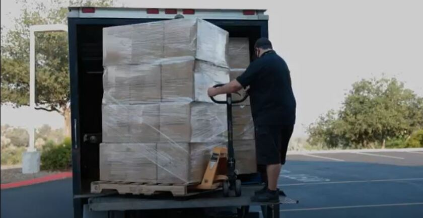 Ryan Alvarez, production manager for Viejas Entertainment & Production, helps unload face masks for the Alpine schools.