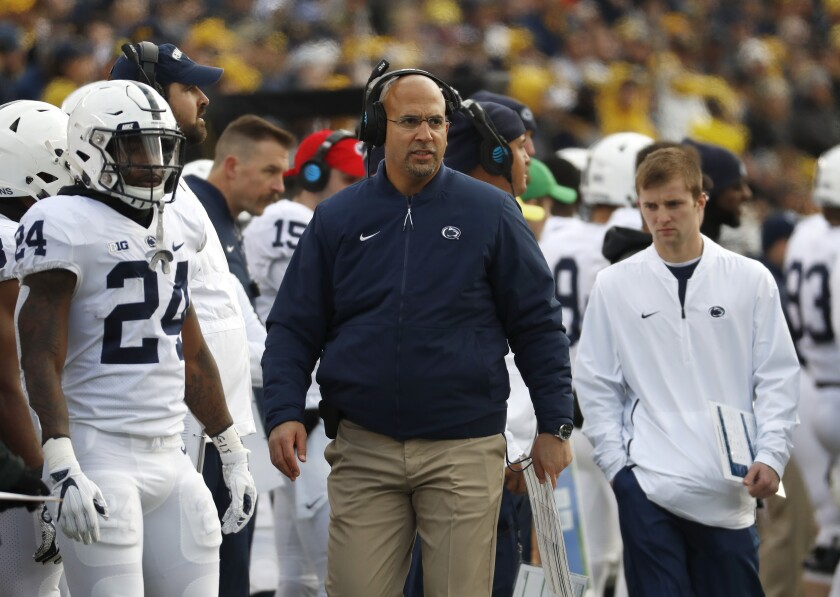 FILE - In this Nov. 3, 2018, file photo, Penn State head coach James Franklin watches in the first half of an NCAA college football game against Michigan in Ann Arbor, Mich. For good reason, Maryland first-year coach Mike Locksley has no desire to look into the past before leading the Terrapins into Friday night's matchup with No. 12 Penn State. Locksley insists recent results in the terribly lopsided Penn State-Maryland series will have no bearing on what happens before a rare sellout crowd in College Park for the Big Ten opener. Funny thing is, Nittany Lions coach James Franklin agrees with the assessment. (AP Photo/Paul Sancya, File)