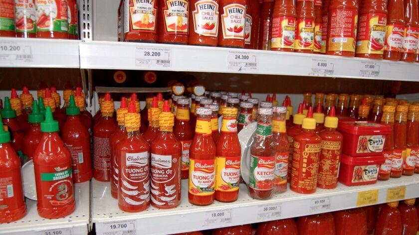 Sriracha on a shelf in Vietnam
