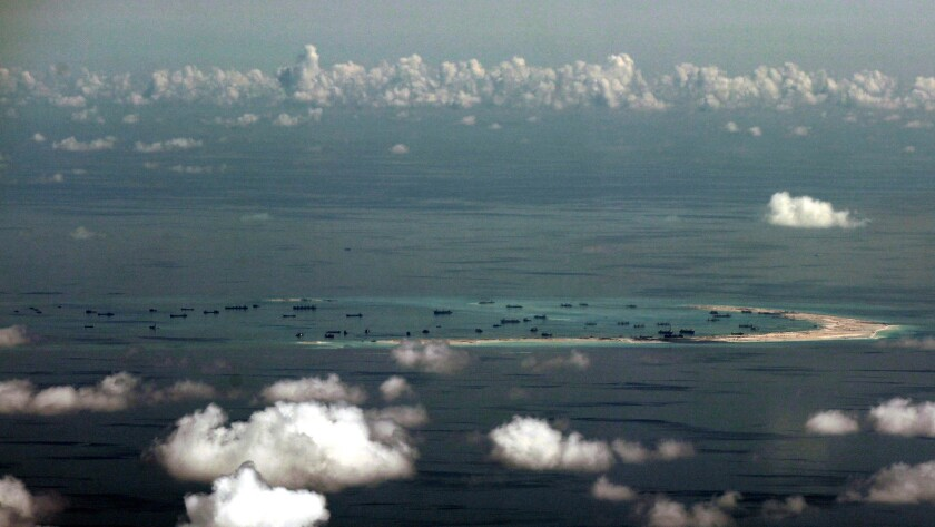 A May 11, 2015, aerial view of artificial islands built by China in disputed waters in the South China Sea, west of Palawan, Philippines.