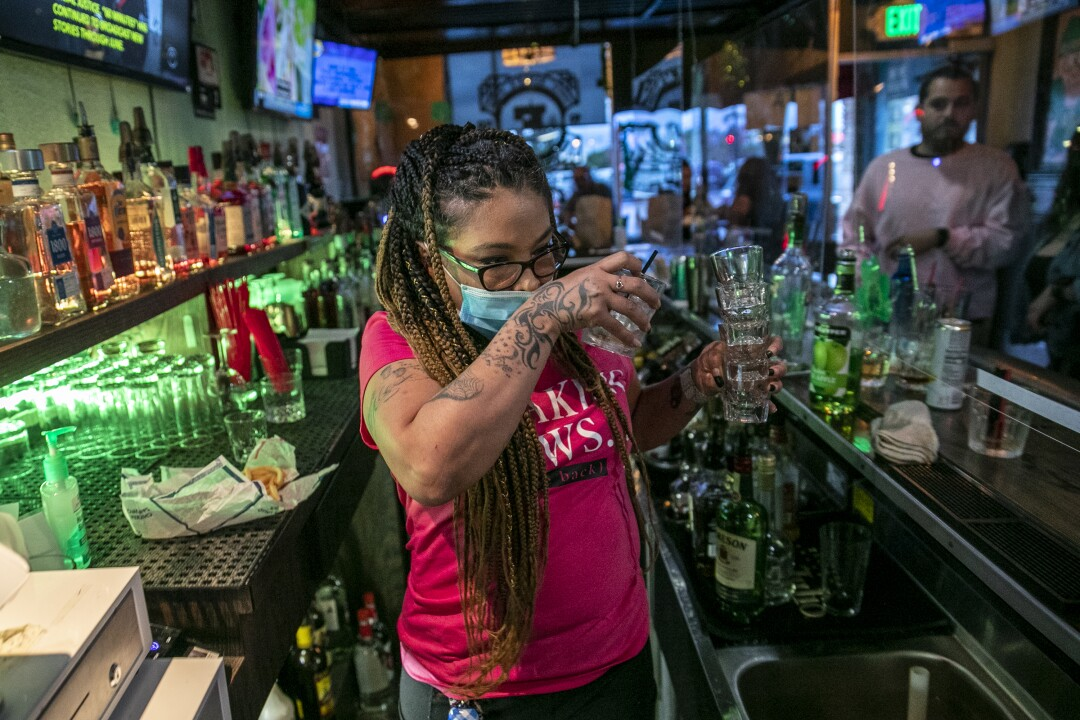 Bartender Christina Flintland serves drinks at Elvie's Public House in Covina.