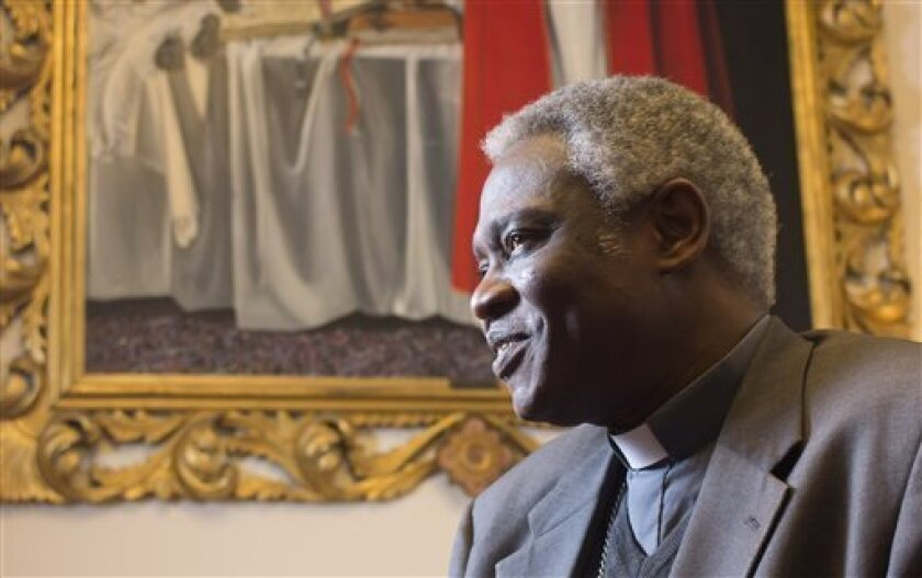 ADD FEB. 12 - Ghanaian Cardinal Peter Kodwo Appiah Turkson talks to the Associated Press during an interview, in Rome, Tuesday, Feb. 12, 2013. One of Africa's brightest hopes to be the next pope, Ghanaian Cardinal Turkson, says the time is right for a pontiff from the developing world. In the backg